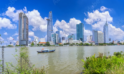Foto  Ho Chi Minh City, Vietnam - May 1st, 2017:  Skyscrapers along river with archite