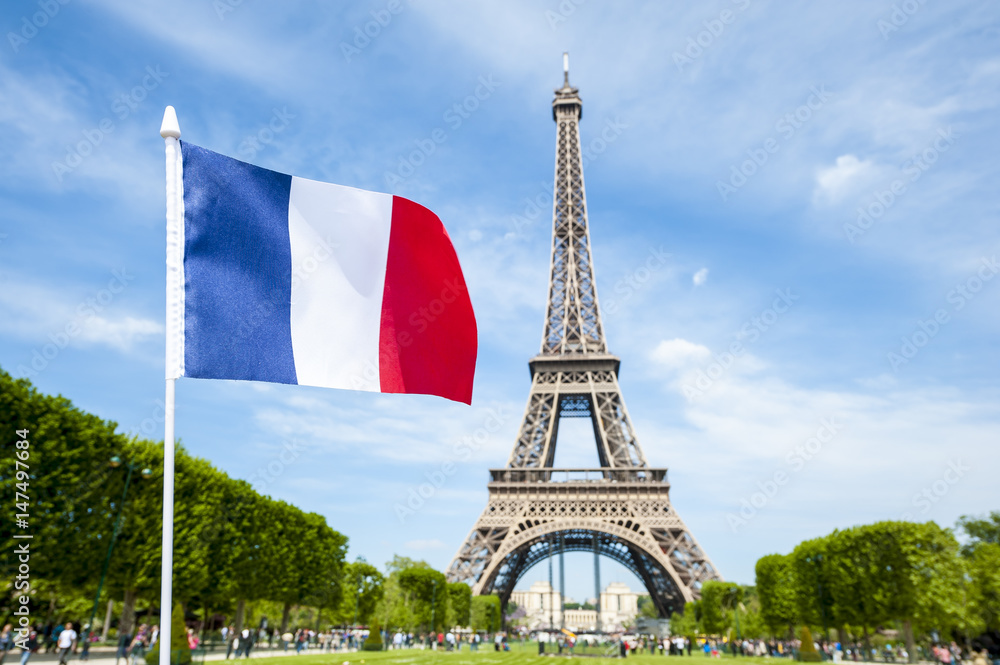 Fototapety, obrazy: French flag flying in bright blue sky above the Eiffel Tower in Paris, France