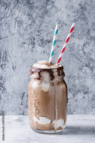 Foto op Plexiglas Milkshake Chocolate coffee milkshake with ice cream scoop served in glass mason jar with retro cocktail tubes on gray texture background. Summer sweet drink