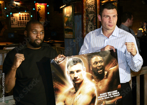 Vitali Klitschko and Danny Williams pose with autographed