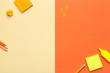 Leinwanddruck Bild - Office Accessories on Yellow and Orange Background