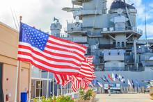 American Flags At Missouri Battleship Memorial In Pearl Harbor Honolulu Hawaii, Oahu Island Of United States. National Historic Patriotic Landmark.