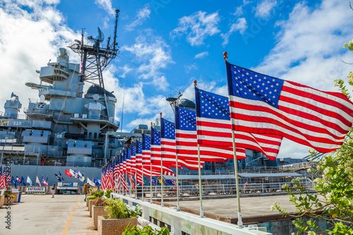 Canvas Prints Historical buildings American flags in line at Missouri Warship Memorial in Pearl Harbor Honolulu Hawaii, Oahu island of United States. National historic patriotic landmark.