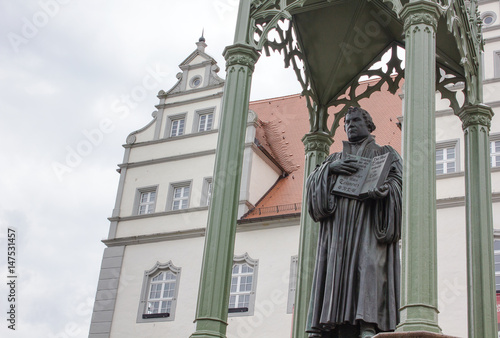 Fotografie, Obraz  Martin Luther / Sculpture of the reformer Martin Luther in Wittenberg