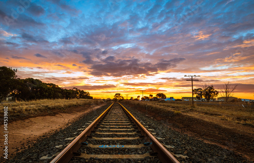 Poster Voies ferrées Railway tracks at sunset scenic rural Australian landscape