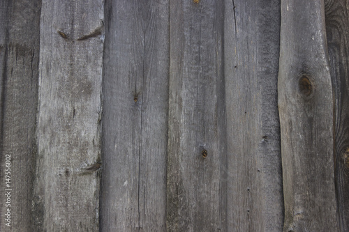 The Wall Of An Old Barn Whose Walls Are Crookedly Boarded With Wooden Boards