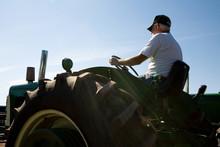 Senior Farmer Driving Tractor