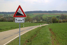 Road Sign Sloping Road