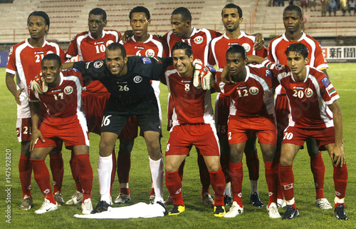 Members of Oman's national soccer team pose for a photo