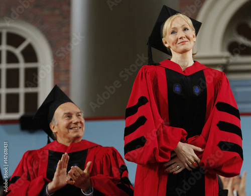 Prince Karim Aga Khan applauds as fellow honorary degree recipient British author Rowling stands to receive
