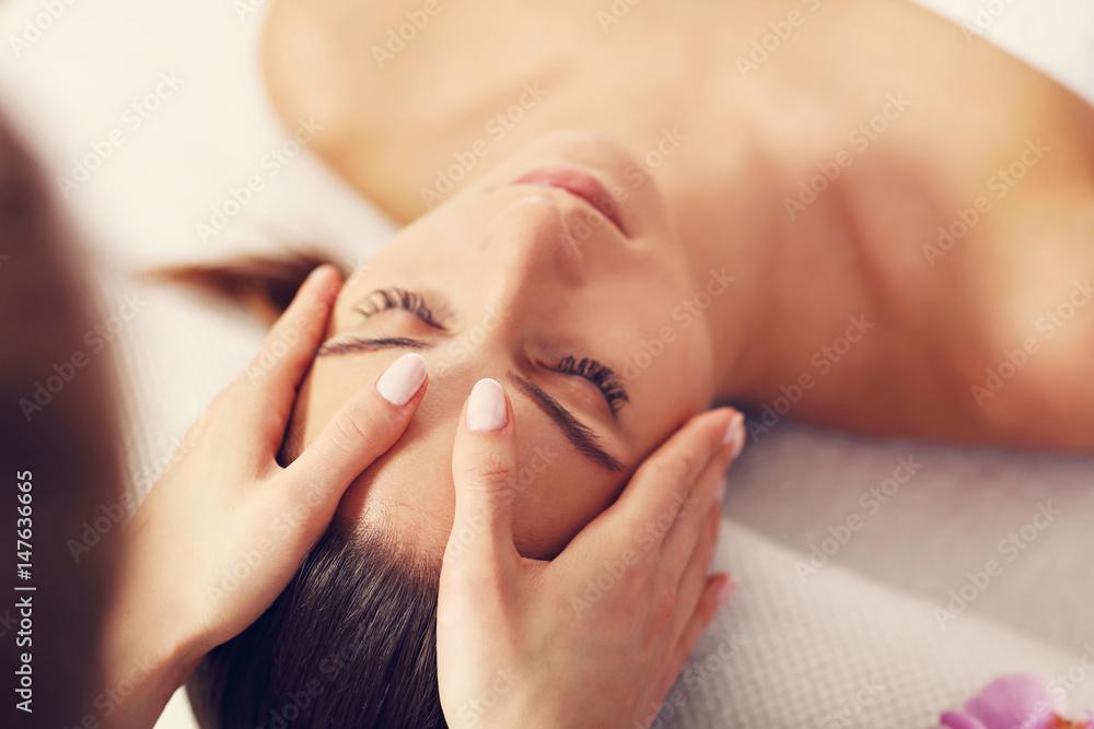 Fototapeta Beautiful woman getting massage in spa