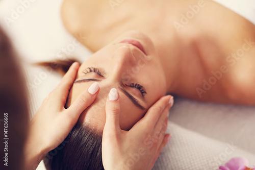 Leinwand Poster Beautiful woman getting massage in spa
