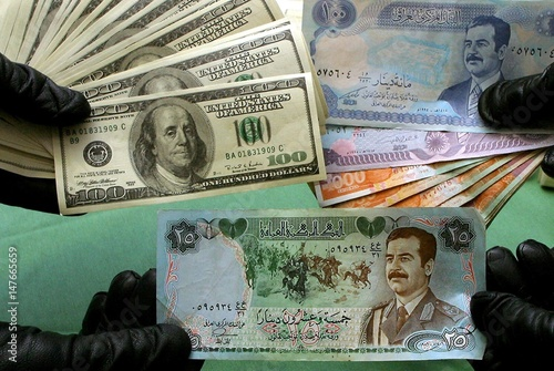 Italian Police Officers Show Off Seized Counterfeit Iraqi Dinar And Us Dollar Banknotes At A Central