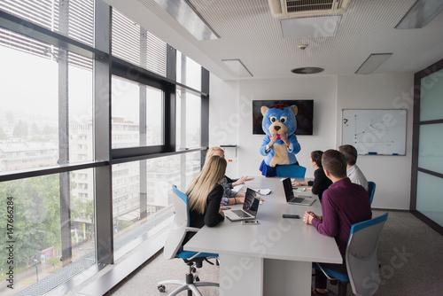 Fototapeta boss dresed as bear having fun with business people in trendy office obraz na płótnie