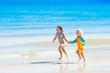 Kids run and play on tropical beach