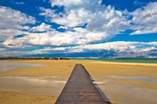 Wooden Boardwalk And Sand Beach Of Nin
