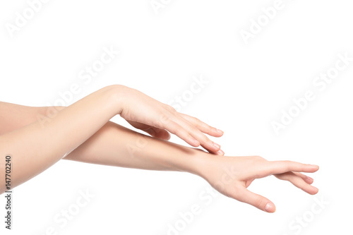 Valokuva  Hands of beautiful young woman on white background