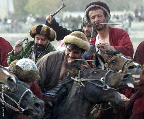 AFGHAN RIDERS FIGHT FOR THE GOAT DURING A BUZKASHI GAME IN KABUL