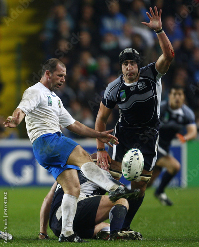 Scotland's Brown tries to intercept a drop kick by Italy's