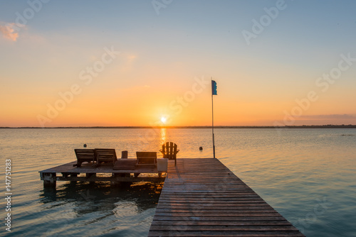 Tuinposter Pier Sunrise on the boardwalk in Bacalar, Mexico
