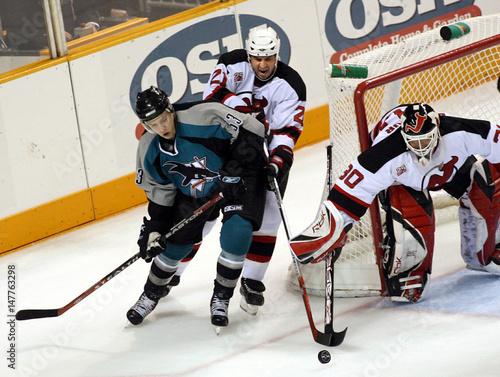 San Jose Sharks' Joe Pavelski chases the puck as New Jersey