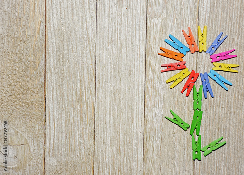 Flower Made From Colorful Clothespins On A Wooden Background Great
