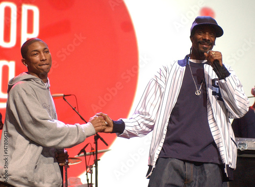 Rapper Snoop Dogg greets hip hop artist Pharrell during the