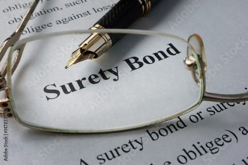Page of newspaper with words surety bond. Canvas Print