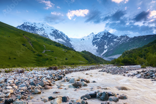 Beautiful mountain stream with colorful stones.
