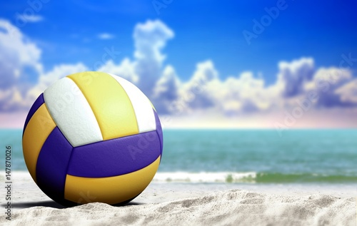 Volleyball on the beach with open sea and cloudy blue sky