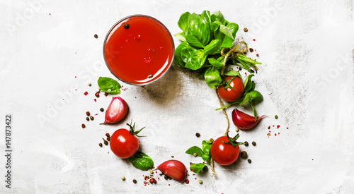 Food background, banner, tomato juice, green basil, cherry tomatoes, garlic, salt, spices. Top view, flat lay