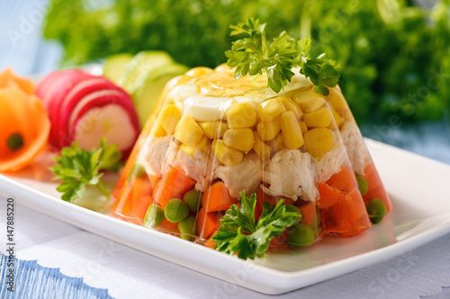 Photo Aspic- jellied chicken with egg and vegetables.