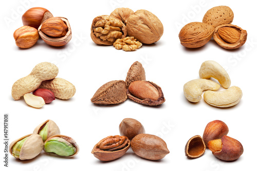 obraz lub plakat Collection of various nuts on white.