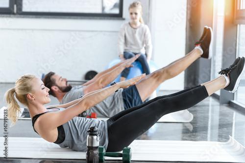 Fotografie, Obraz  People doing gymnastics at fitness studio