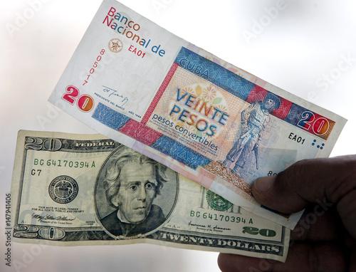 Cuban Holding U S Dollar And Convertible Peso Bills