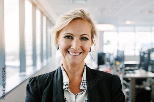 Valokuva  Successful mature businesswoman standing in office