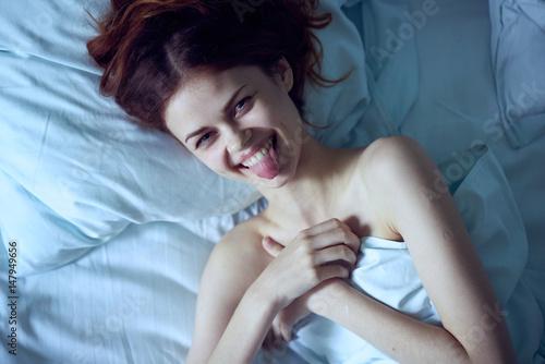 Fototapeta happy woman in bed, morning awakening obraz na płótnie