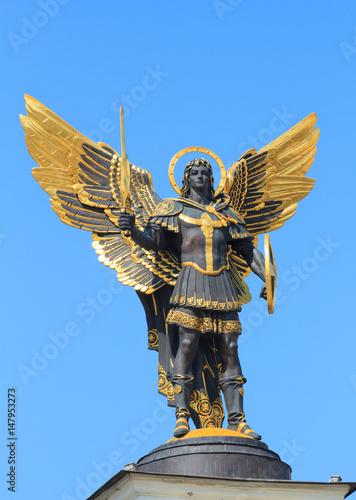 Leinwand Poster Golden statue of Archangel Michael  in Kiev