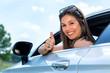 Leinwandbild Motiv Young female car driver doing thumbs up.