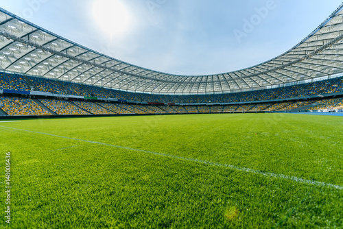 Panoramic view of soccer field stadium and stadium seats Poster