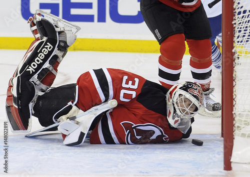 New Jersey Devils goalie Brodeur reacts as puck bounces out