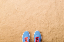 Blue Sports Shoes Laid On Sand Beach, Studio Shot