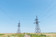 two electrical tower and blue sky