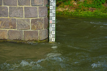 Stone Pillar And Water Level Meter On The River