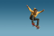 A Teenager Skateboarder Does A...