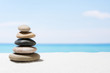 Relaxing in the tropical beach, with white sand and stack of stones