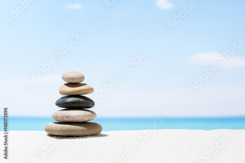 Poster de jardin Zen pierres a sable Relaxing in the tropical beach, with white sand and stack of stones