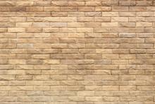 Background Of Yellow Facing Bricks. Bricks Relief Close Up.