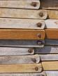 Stacked wooden deckchairs