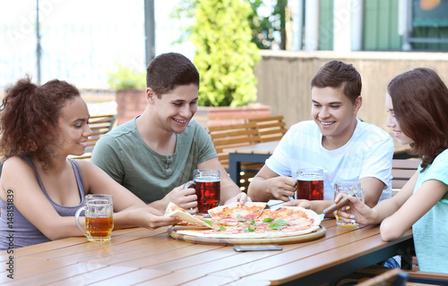 Happy friends in pizzeria